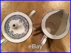 68 pcs Noritake China set Charleston 7148 Ivory withplatinum trim and bl leaf vine